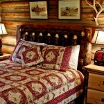 bed in cabin, quilted blanket