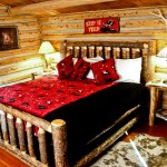 bed in cabin, red and black blanket