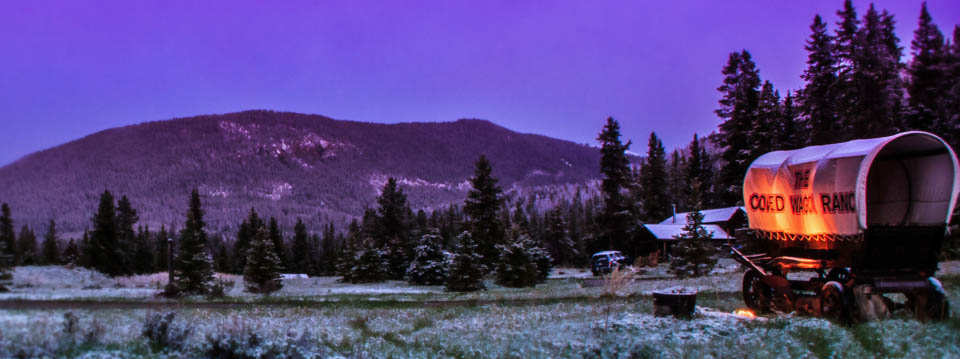 covered wagon ranch at night