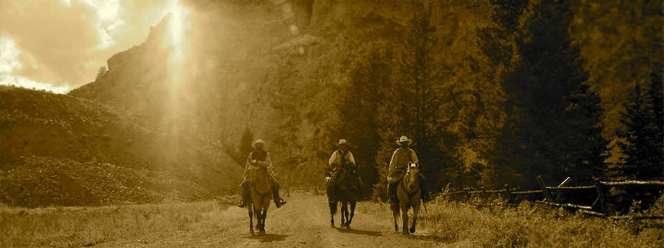 sepia tone image of 3 horseback riders